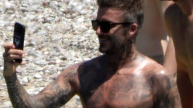 Photo of Topless David Beckham exhibits off his tan in Versace swimming shorts on vacation with Romeo, Cruz and Brooklyn in Greece